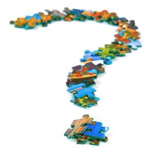 puzzelstukjes in de vorm van een vraagteken bij blog Wanneer is genoeg genoeg?